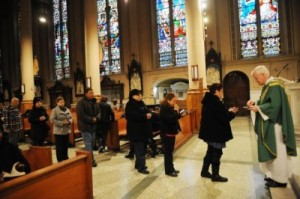Photo of women in line for holy communion, a time when purses can be stolen from the pews.